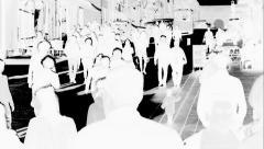 Crowd walking in pedestrian street, black & white negative, slow motion Stock Footage