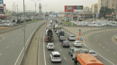 Highway traffic, upper view, city is in the background, traffic jam Stock Footage