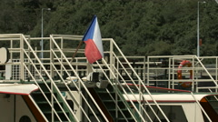 Stairs leading to a boat top deck and a Czech flag waving, Prague Stock Footage