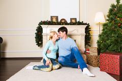 Christmas Couple. Happy Smiling Family at home celebrating.New Year People - stock photo