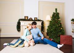 Christmas Couple. Happy Smiling Family at home celebrating.New Year People Stock Photos