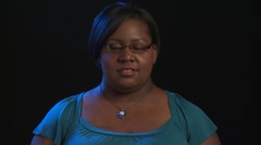 Pretty Plus-sized African Amercian Woman is sad and slumps shoulders Stock Footage
