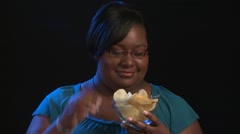 Woman Eats Potato Chips - African American, Black Background - stock footage