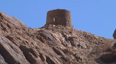 Zoom out of hillside with ancient tower atop. Ladakh, Jammu and Kashmir, India Stock Footage