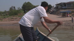 Man on boat, Luang Prabang, Laos Stock Footage