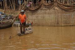 Fisherman with fishing net Stock Photos
