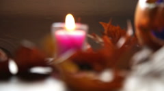 panning from blurred candle to focused pumpkin - stock footage