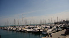 Boats sway in the wind at a marina in Chicago Stock Footage