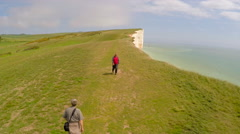 Aerial shot of people walking along the White Cliffs of Dover at Beachy Head, Stock Footage