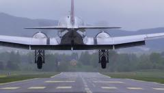 Douglas DC-3 landing on airstripe rear view ambient audio Stock Footage
