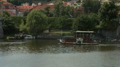 Boat floating on Vltava River near Prague Castle Stock Footage