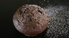 4K Close up of icing sugar falling onto the top of a double chocolate muffin Stock Footage