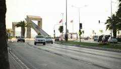 IZMIR - KARSIYAKA, JULY 2015: Statues and traffic at afternoon Stock Footage
