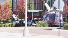 News crew trucks at a crime scene Stock Footage