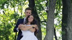 Happy  bride and groom are dancing in park in their wedding day. first wedding Stock Footage