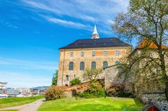 Medieval castle Akershus Fortress with Oslofjord - stock photo