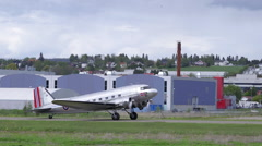 Stock Video Footage of Douglas DC-3 taxiing left to right airfield side view