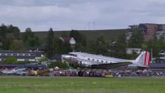 Douglas DC-3 take off from airfield side view ambient sound Stock Footage