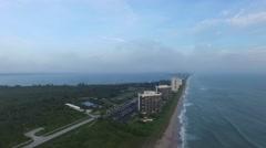 Sunrise coastline view south from 9200 S Ocean Dr, Jensen Beach, FL - stock footage