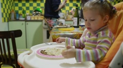 Stock Video Footage of Little Girl Eating Noodle By Herself
