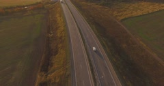Beautiful autumn automobile highway, field, forest. - stock footage