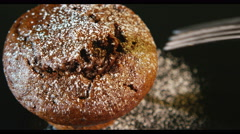 4K Close up of a fork cutting into a double chocolate muffin - stock footage