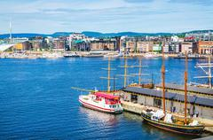 Transport ship in harbor by Aker Brygge, Oslo - stock photo