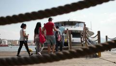 Passengers getting in to ferry at Pasaport ferry station to go Karsiyaka station Stock Footage