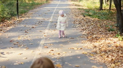 Mother and child walking in park - stock footage