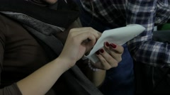 Stock Video Footage of Women sewing with needle on art workshop for production jewelry, hands close up.
