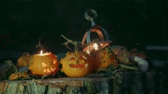 Halloween pumpkins over a tree trunk with autumn decoration Stock Footage