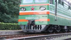 Freight train rides by rail Stock Footage