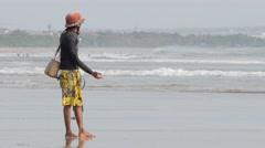 Fisherman on the beach,Kuta,Bali,Indonesia Stock Footage