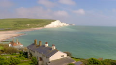 Stock Video Footage of Areal shot of beautiful houses along the shore of the White Cliffs of Dover at