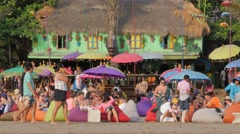 Colorful and busy beach restaurant,Kuta,Bali,Indonesia - stock footage