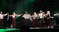 Stock Video Footage of People in ethnic clothing are dancing traditional East European dances