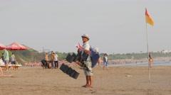 Seller of Kite ships on the beach,Kuta,Bali,Indonesia Stock Footage