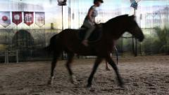 Girl training a horse, trainer trains girl horseback riding - stock footage