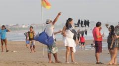 Kite seller tries sell kite to tourist,Kuta,Bali,Indonesia Stock Footage