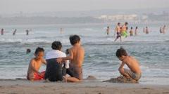 Boys making sand castle on the beach,Kuta,Bali,Indonesia Stock Footage