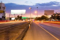 Street light at twilight time. blank billboard for advertisement. Stock Photos