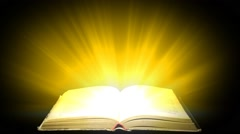 Concept of love for book. Magic light escapes from the book Stock Footage