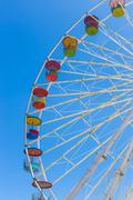 Giant ferris wheel in Amusement park with blue sky background Kuvituskuvat