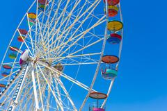 Giant ferris wheel in Amusement park with blue sky background - stock photo