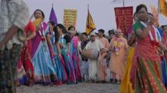 Hare Krishna procession on the beach,Kuta,Bali,Indonesia Stock Footage
