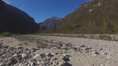AERIAL: Flying over river bed in the swiss mountains Stock Footage