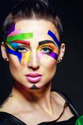 Stylist with face art portrait. Stock Photos