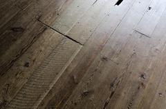 Old wood floor in cabin - stock photo