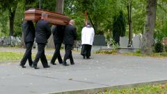 Funeral. Men are carrying coffin - stock footage