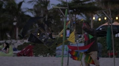 Kite seller collects his kites in the evening,Kuta,Bali,Indonesia Stock Footage